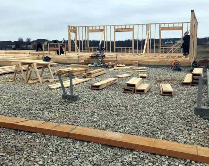 Amish builders working hard framing up a new home construction project near Springfield, Missouri.