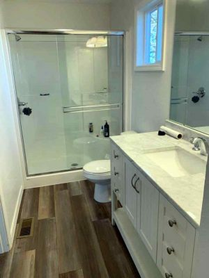 A recent custom bathroom remodeling project with walk-in shower, marble countertop and new flooring